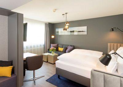 Apartment Hotel Lyskirchen Koeln Bett und Sitzbereich